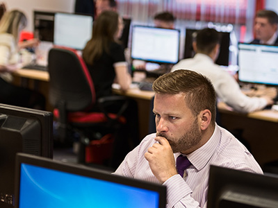 wesley plumb, thinking, at a computer, inside whitehall resources offices